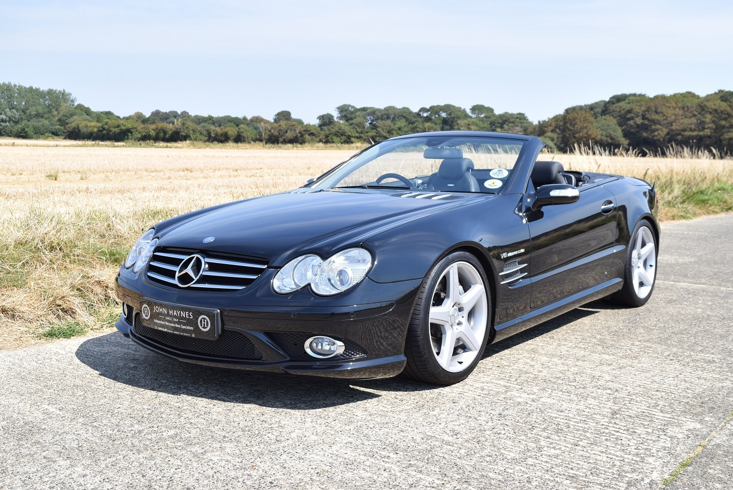 SL55 AMG front quarter roof down